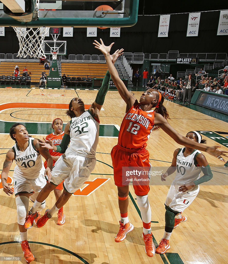 Morgan Stroman #32 of the Miami Hurricanes and Quinyotta Pettaway #12 of the Clemson Lady Tigers fight for control of the rebound on January 3, 2013 at the BankUnited Center in Coral Gables, Florida. miami defeated Clemson 78-56.