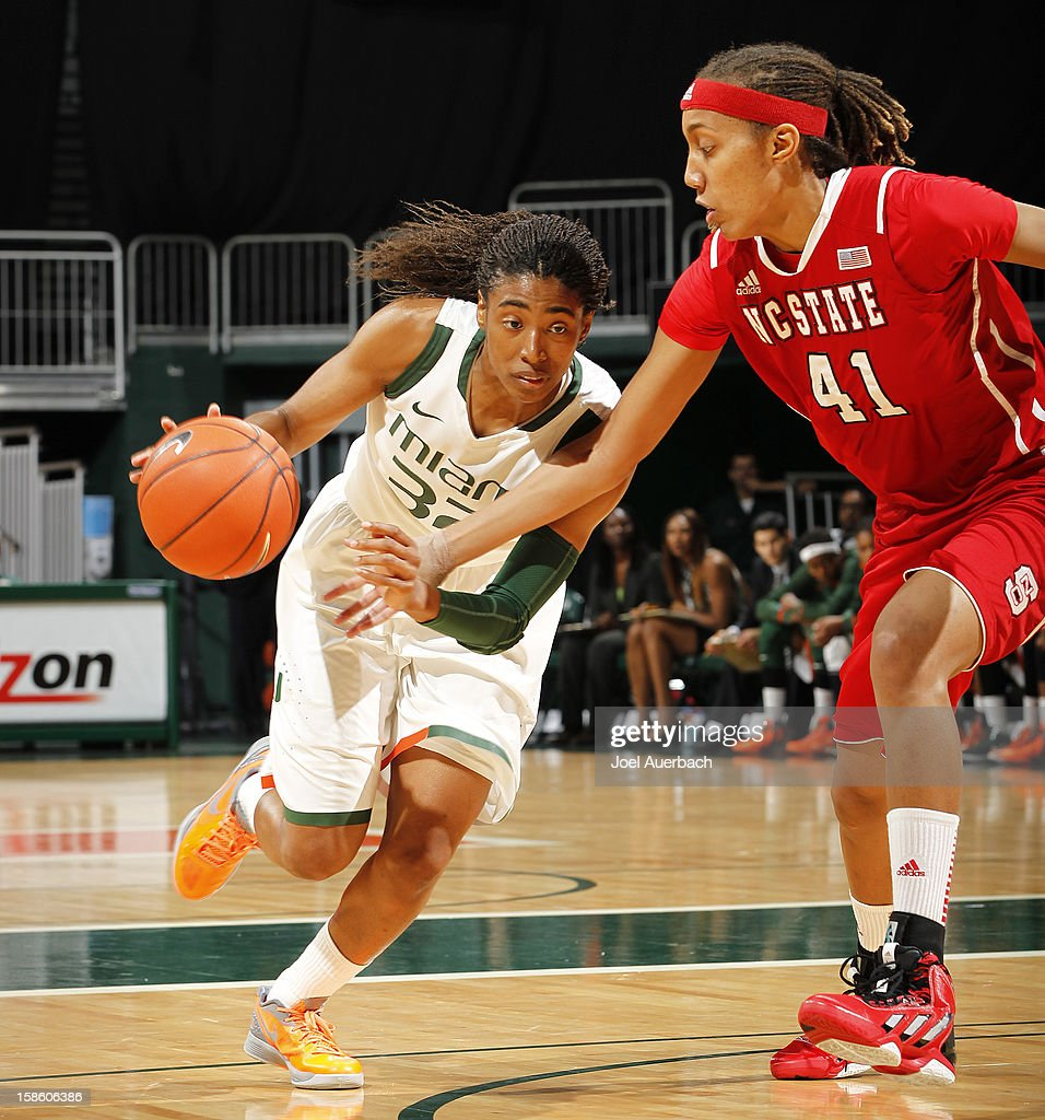 Morgan Stroman #32 of the Miami Hurricanes dribbles the ball while being defended by Lakeesa Daniel #41 of the North Carolina State Wolfpack on December 20, 2012 at the BankUnited Center in Coral Gables, Florida.