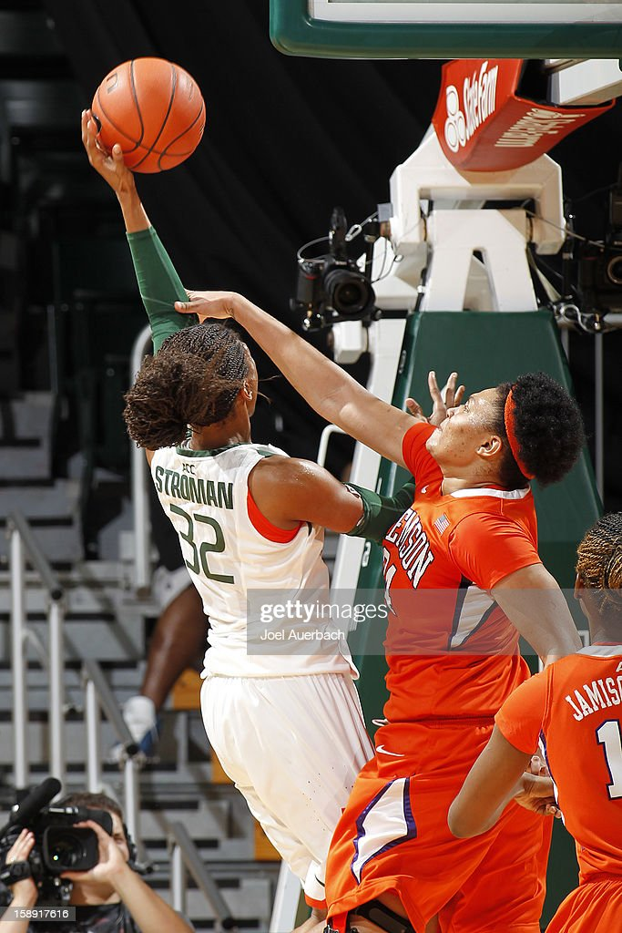 Morgan Stroman #32 of the Miami Hurricanes goes to the basket against Natiece Ford #34 of the Clemson Lady Tigers on January 3, 2013 at the BankUnited Center in Coral Gables, Florida. miami defeated Clemson 78-56.