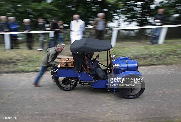 Morgan Three Wheeler is given a push up the Test Hill at The Brooklands Double Twelve Motorsport Festival on June 18 2011 in Weybridge England Two...