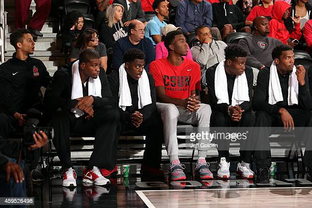 Morgan Tilford Kevin Johnson Miles NolenWebb Zaccary Douglas Micheal Warren and Jerron Wilbut of the CSUN Matadors sit on the bench as they eye the...