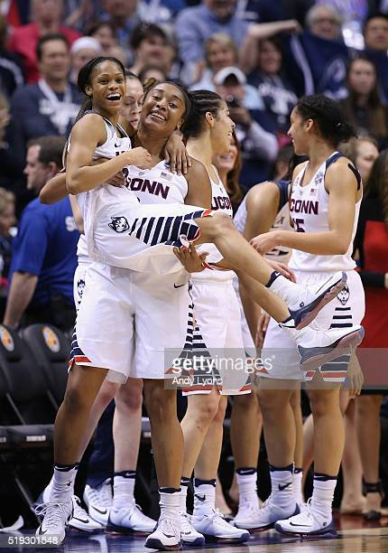 Morgan Tuck and Moriah Jefferson of the Connecticut Huskies embrace as they take the bench in the fourth quarter against the Syracuse Orange during...