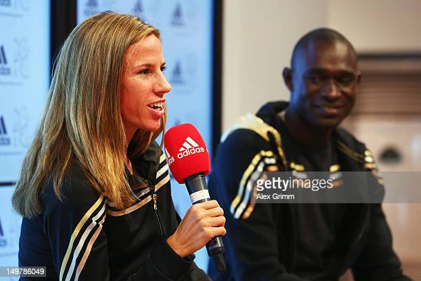 Morgan Uceny of the United States and David Rudisha of Kenya at the adidas Olympic Media Lounge at Westfield Stratford City on August 4, 2012 in...