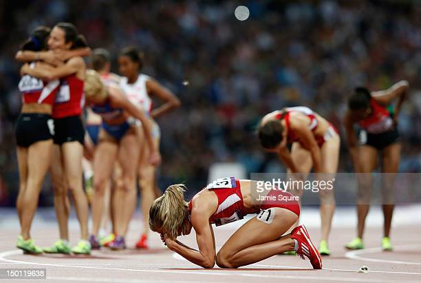 Morgan Uceny of the United States reacts after falling as athletes celebrate behind her during the Women's 1500m Final on Day 14 of the London 2012...