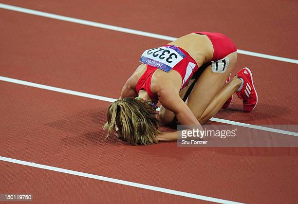 Morgan Uceny of the United States reacts after falling during the Women's 1500m Final on Day 14 of the London 2012 Olympic Games at Olympic Stadium...