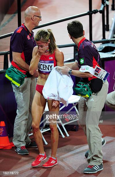 Morgan Uceny of the United States receives assistance after falling and failing to finish in the Women's 1500m Final on Day 14 of the London 2012...