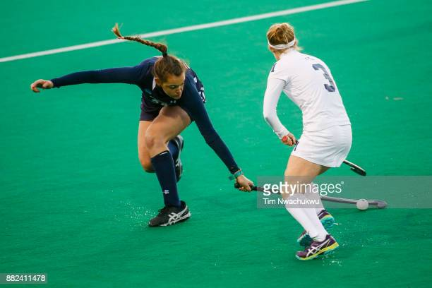 Morgan Vasiliu of Messiah College dispossesses Molly Freeman of Middlebury College during the Division III Women's Field Hockey Championship held at...