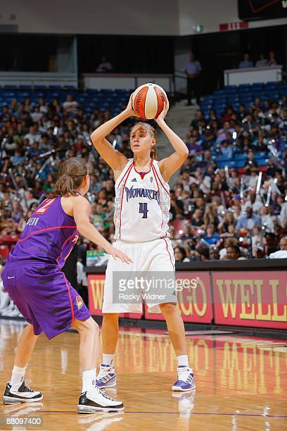 Morgan Warburton of the Sacramento Monarchs moves the ball against Laurie Koehn of the Phoenix Mercury during the WNBA preseason game on May 27 2009...