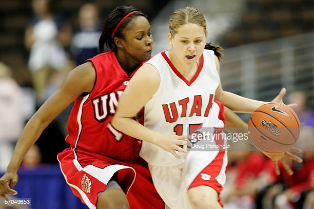 Morgan Warburton of the Utah Utes brings the ball upcourt under defensive pressure from Nejlah Clark of the UNLV Lady Rebels as the Utes defeated the...