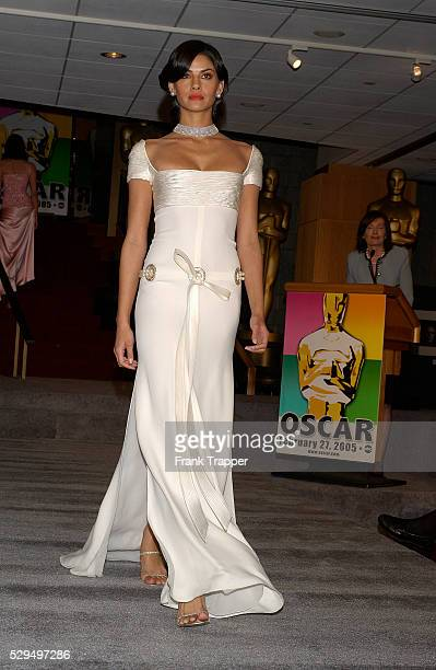 Morgan wears fashion designer Valentino ivory shirred bodice with pears and Martin Katz baroque pearl necklace pearl ear clips at the 77th Annual...