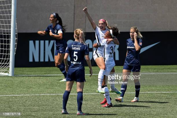 Morgan Weaver of Portland Thorns FC celebrates after scoring a goal in the 68th minute against Katelyn Rowland of North Carolina Courage during the...
