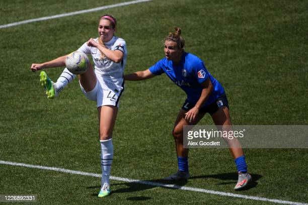 Morgan Weaver of Portland Thorns FC fights for theball with Amber Brooks of OL Reign during a game on day 8 of the NWSL Challenge Cup at Zions Bank...