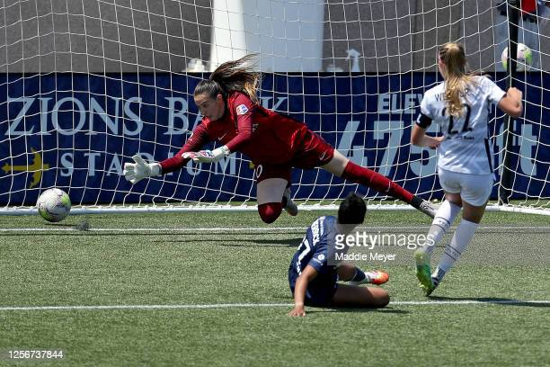 Morgan Weaver of Portland Thorns FC scores a goal in the 68th minute against Katelyn Rowland of North Carolina Courage during the second half in the...