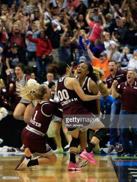 Morgan William of the Mississippi State Lady Bulldogs celebrates with teammates after making the gamewinning shot to defeat the Connecticut Huskies...