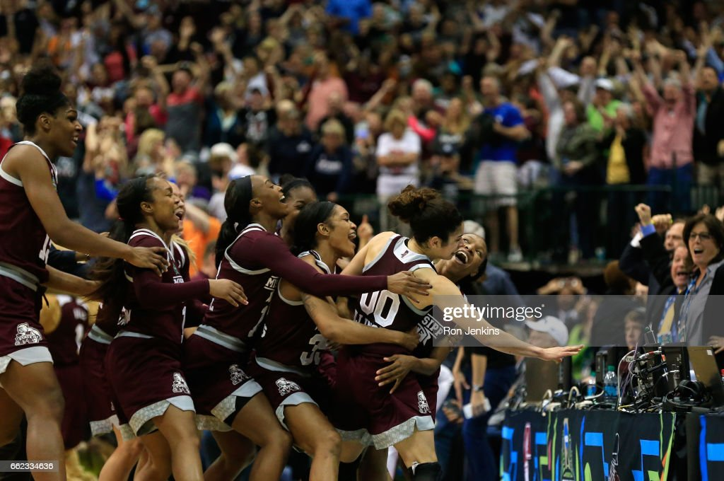 Morgan William #2 of the Mississippi State Lady Bulldogs celebrates with teammates after making the game-winning shot to defeat the Connecticut Huskies 66-64 in overtime during the semifinal round of the 2017 NCAA Women's Final Four at American Airlines Center on March 31, 2017 in Dallas, Texas.