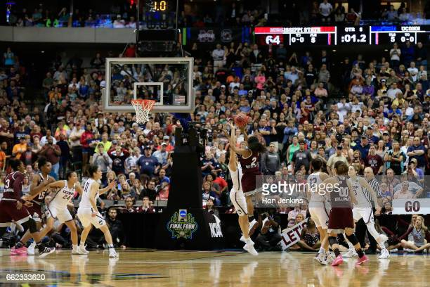 Morgan William of the Mississippi State Lady Bulldogs shoots to score and win the game 6664 against the Connecticut Huskies in overtime during the...