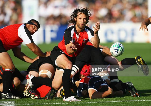 Morgan Williams of Canada passes the ball out during the Rugby World Cup Pool B match between Canada and Japan at the Stade Chaban Delmas on...