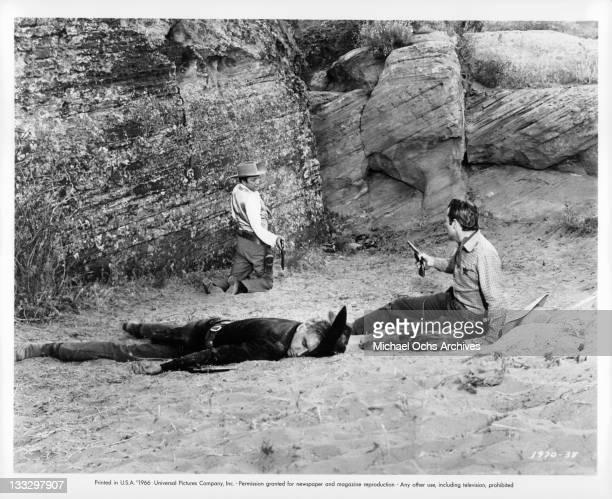 Morgan Woodward lies dead as Warren Stevens fight for money Morgan carried in a scene from the film 'Gunpoint' 1966