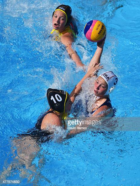 Morgane Le Roux of France and Nadien Hartwig of Germany battle for the ball during the Women's Water Polo semi final 710 match between France and...
