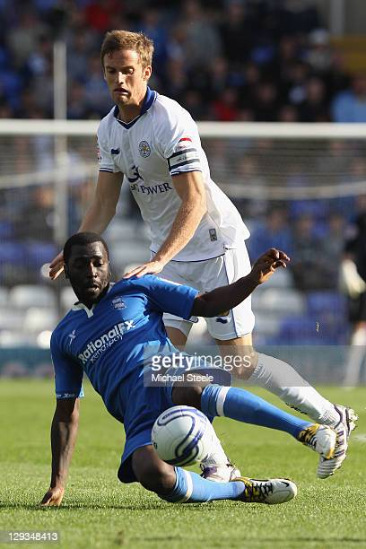 Morgaro Gomis of Birmingham City challenged by Matt Mills of Leicester City during the npower Championship match at St Andrews on October 16 2011 in...