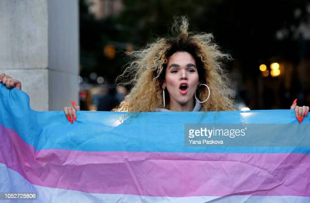 Morgin Dupont a woman of trans experience holds up the flag for Transgender and Gender Noncomforming people at a rally for LGBTQI rights at...