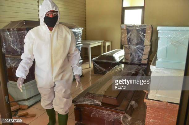 A morgue worker prepares coffins for victims of the COVID19 coronavirus outbreak in Bekasi West Java on April 1 2020 It is not common for Muslims in...