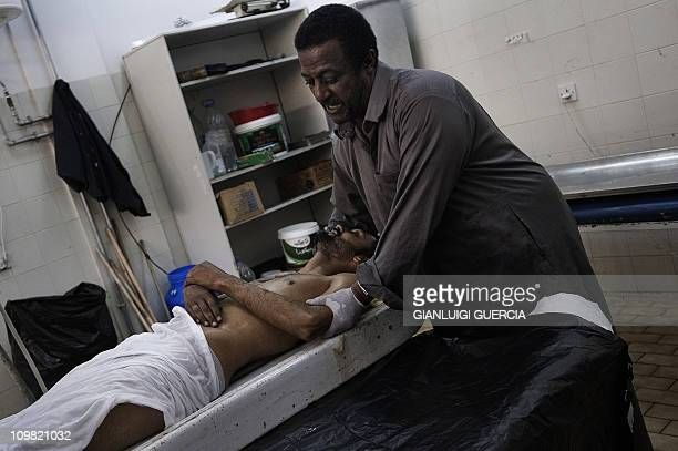 A morgue workers moves the body of a Libyan rebel fighter killed in a battle with supporters of Moamer Kadhafi over the control of the coastal hamlet...