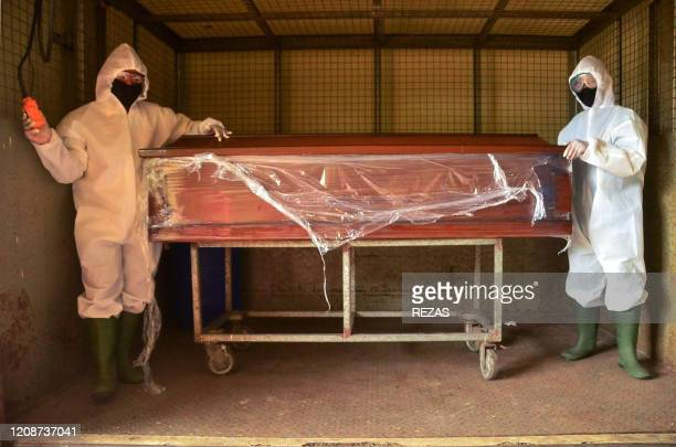Morgue workers prepare coffins for victims of the COVID19 coronavirus outbreak in Bekasi West Java on April 1 2020 It is not common for Muslims in...