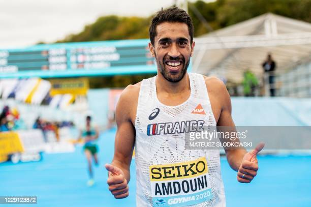 Morhad Amdouni of France poses after finishing eighth in the men's race of the 2020 IAAF World Half Marathon Championships in Gdynia Poland in...