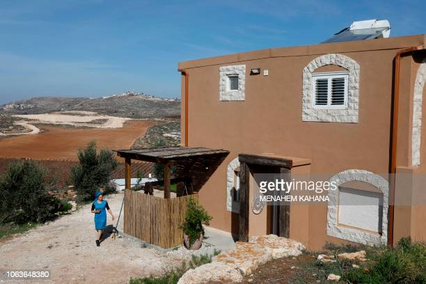 Moria Shapira Airbnb's apartment owner walks outside of her apartment in Adei Ad outpost north of the Palestinian village of alMughayyir near the...