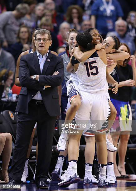Moriah Jefferson and Gabby Williams of the Connecticut Huskies embrace as they take the bench in the fourth quarter against the Syracuse Orange...
