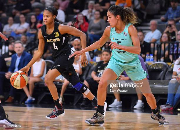 Moriah Jefferson of the Las Vegas Aces drives against Kia Nurse of the New York Liberty during their game at the Mandalay Bay Events Center on August...