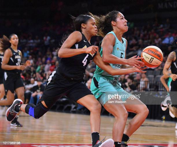 Moriah Jefferson of the Las Vegas Aces steals the ball from Kia Nurse of the New York Liberty during their game at the Mandalay Bay Events Center on...