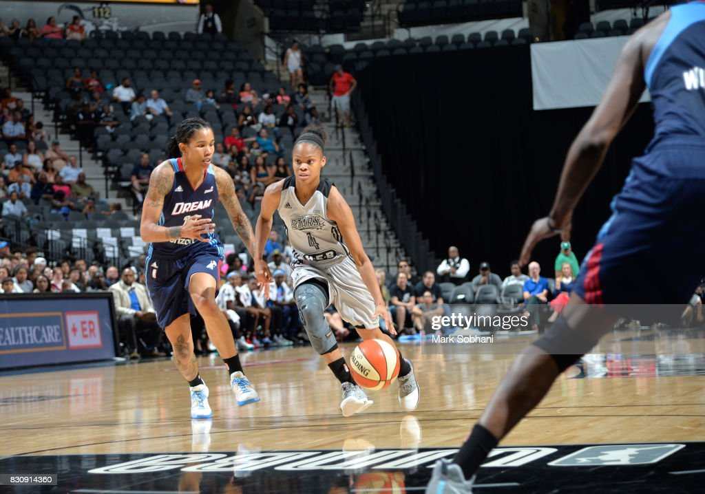 Moriah Jefferson #4 of the San Antonio Stars handles the ball against Tamera Young #11 of the Atlanta Dream on August 12, 2017 at the AT&T Center in San Antonio, Texas.