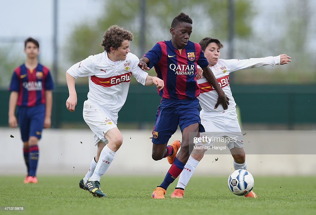 Moriba Kourouma Kourouma (C) of Barcelona is challenged by Jordan Meyer (L) of Stuttgart and Melih Caliskan (R) of Stuttgart during the Final of the Santander Cup for U13 teams between FC Barcelona and VfB Stuttgart at Borussia Park Fohlenplatz on April 26, 2015 in Moenchengladbach, Germany.
