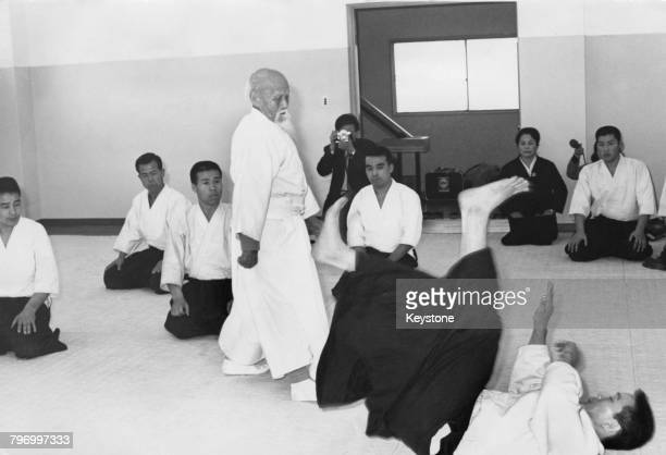Morihei Ueshiba founder of the Japanese martial art of aikido demonstrating his art with a follower at the opening ceremony of the newlyopened aikido...