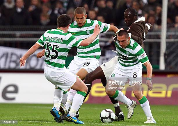 Morike Sako of St Pauli Paul McGowan Joshua Thompson and Scott Brown of Celtic battle for the ball during the friendly match between FC St Pauli and...