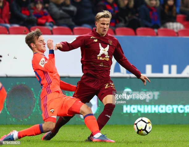 Moritz Bauer of FC Rubin Kazan vies for the ball with Aleksandr Golovin PFC CSKA Moscow during the Russian Premier League match between FC Rubin...