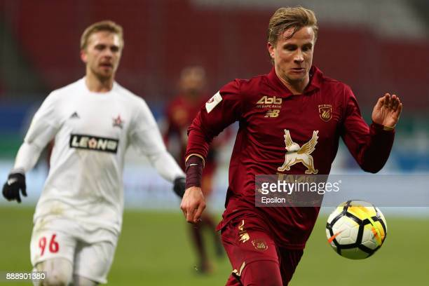 Moritz Bauer of FC Rubin Kazan vies for the ball with Alksandr Maksimenko SKA Khabarovsk during the Russian Premier League match between FC Rubin...