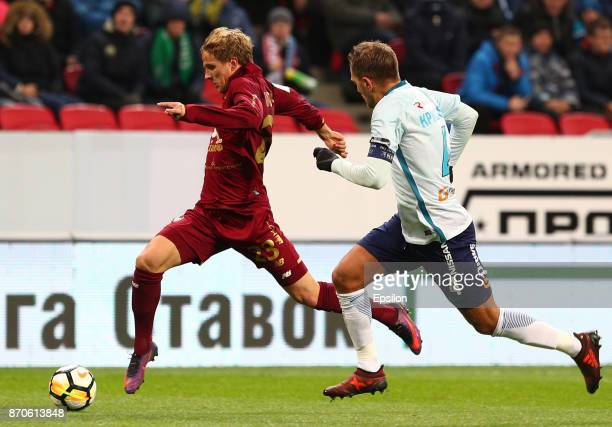 Moritz Bauer of FC Rubin Kazan vies for the ball with Domenico Criscito FC Zenit Saint Petersburg during the Russian Premier League match between FC...