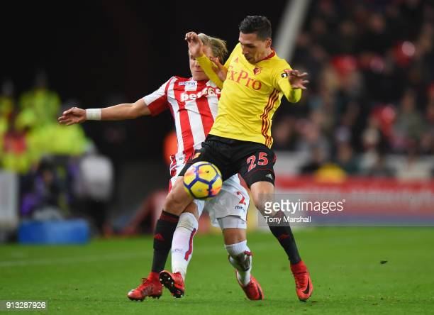 Moritz Bauer of Stoke City challenges Jose Holebas of Watford during the Premier League match between Stoke City and Watford at Bet365 Stadium on...