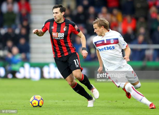 Moritz Bauer of Stoke City chases down Charlie Daniels of AFC Bournemouth during the Premier League match between AFC Bournemouth and Stoke City at...