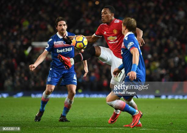 Moritz Bauer of Stoke City closes down Anthony Martial of Manchester United during the Premier League match between Manchester United and Stoke City...