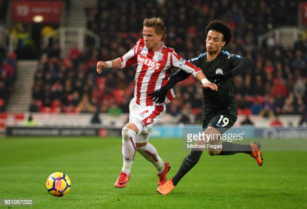 Moritz Bauer of Stoke City holds off Leroy Sane of Manchester City during the Premier League match between Stoke City and Manchester City at Bet365...