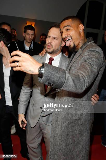 Moritz Bleibtreu and KevinPrince Boateng take a selfie as they attend the 'Nur Gott kann mich richten' premiere at CineStar Metropolis on January 22...
