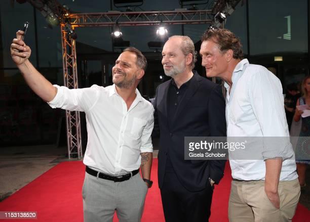 """Moritz Bleibtreu, Ferdinand von Schirach and Oliver Masucci during the """"Schuld nach Ferdinand von Schirach"""" season 3 premiere at the Munich Film..."""