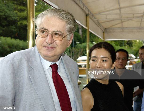 Moritz de Hadeln director of the Venice Film Festival and Gong Li arrive at the dock of the Excelsior Hotel on the Venice Lido
