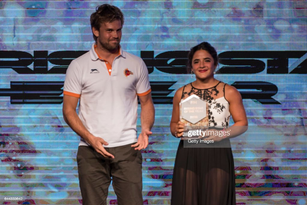 Moritz Fuerste [L] FIH Athletes Committee Representative presents the FIH Female Rising Star of the Year award to Maria Granatto [R] of Argentina...