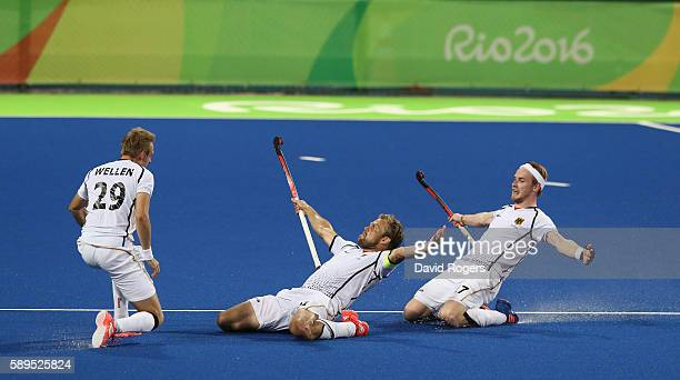 Moritz Furste of Germany who scored a late equalising goal celebrates with team mates Christopher Ruhr and Niklas Wellen during the Men's hockey...