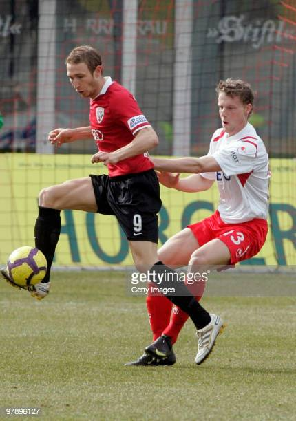 Moritz Hartmann of FC Ingolstadt and Marc Heitmeier of Kickers Offenbach battle for the ball during the 3Liga match between FC Ingolstadt and Kickers...